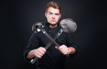 Picture with professional chef holding ladle and skimmer