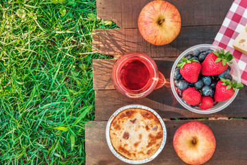 Aluminium Prints Picnic Picnic food and rose wine on green grass with copyspace