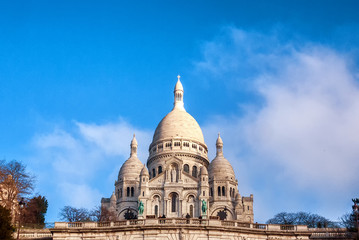 The Basilica Sacre Couer in Paris, France on a mostly clear day