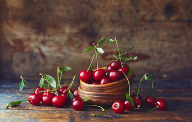 Cherries in a bowl on a wooden table