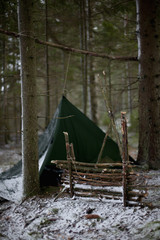 Tent in woodland during winter