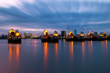 Long exposure, Thames Barrier and Canary Wharf at sunset in London