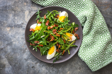 Dandelion salad with eggs and bacon