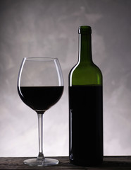 Red wine bottle and wine glass