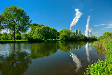 Smoking Coal Power Plant reflecting in river
