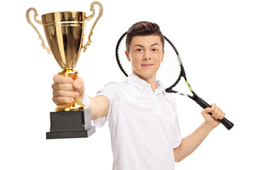 Teenage tennis player holding a golden trophy