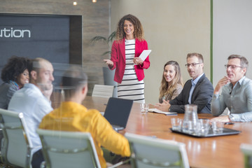 Businesswoman leading a meeting in boardroom