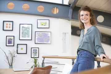 Smiling woman in modern office