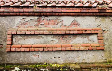 Weathered red bricks are decoratively situated in wall for background texture