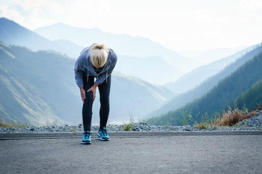 Injuries - sports running knee injury on woman.