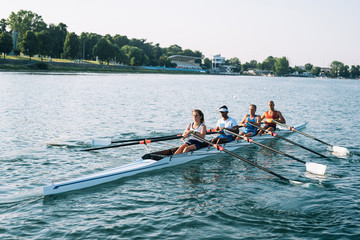 four athlete on canoe rowing