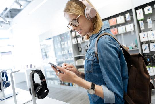 Smart female student shopping for headphones