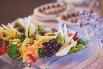 Decorated catering banquet table with different food appetizers assortment on a party