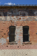 Old Brick Building with Barred Windows