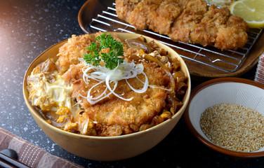 Katsudon or Japanese style fried pork roast .