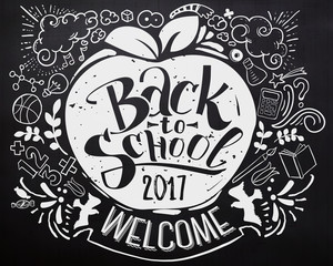 Back to school chalkboard with doodles