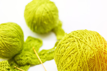 Woolen ball made of thread and knitting needles