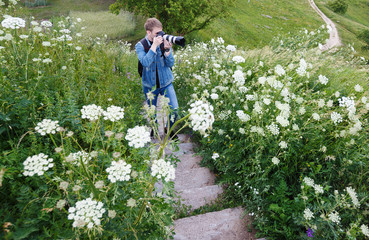 a young photographer photographing a landscape