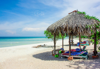 Welcome to paradise! Summer holiday - Sandy tropical beach - sand, sea, sunloungers and sunlight