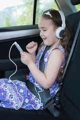 Girl listening music on mobile phone
