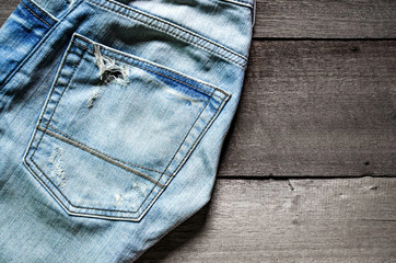 Texture of jeans lack on the wooden floor and blue of jeans, jeans pattern texture and background, jeans texture