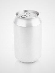 Closed 330 ml aluminum beverage drink soda can on gray background with clipping path