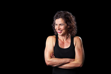 Muscular Woman Smiling Arms Crossed