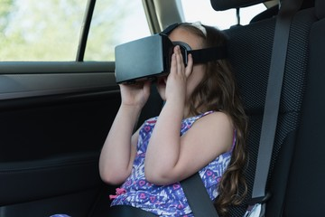 Little girl using virtual reality headset