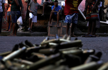 Bullet casings put together by residents, are placed in front of the house of an elderly woman and her daughter who died after being wounded during a violent clash between policemen and drug dealers in Mangueira slum, in Rio de Janeiro