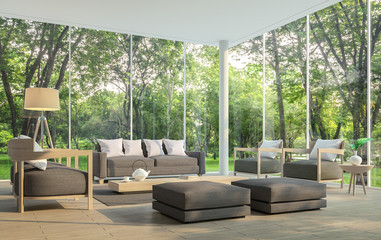 Modern living room with garden view 3d rendering Image.There are large window overlooking the surrounding garden and nature and finished with dark brown furniture