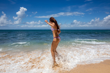 Tanned sexy woman goes into ocean