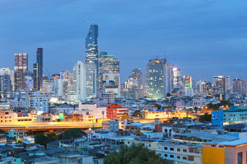 View of Bangkok at twilight time in cityscape.