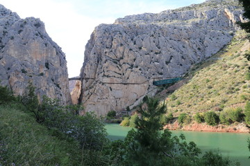 Landscape with the river Guadalorce passing under the bridge of the gorge of the Gaitanes in the Caminito del Rey, Malaga, Spain