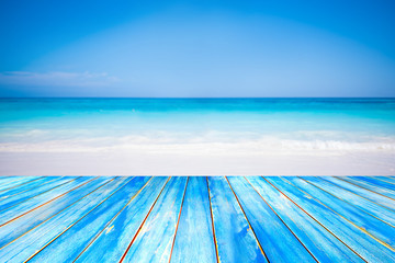 Blue wooden table top on blurred beach background