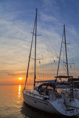 Sailing yacht at sunset in Keramoti, Greece