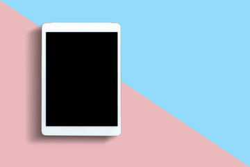 Tablet or mobile phone with black screen on pink and blue background