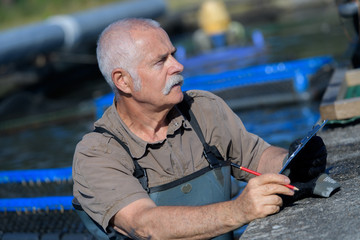 fish farmer counting fishes