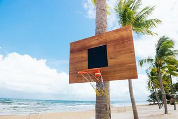Basketball backboard on sunny sky blue day on the tropical beach