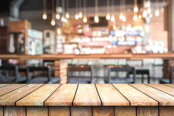 Empty wood top table with space for display product in Blurred cafe background.