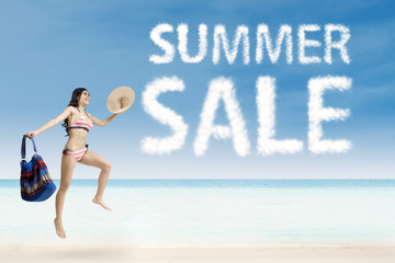 Woman jumping with summer sale cloud