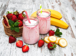 Aluminium Prints Milkshake Yogurt with strawberries and bananas