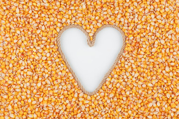 Corn grains and a rope in the shape of a heart with a place for designers.