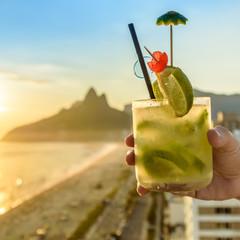 Kiwi caipirinha cocktail overlooking Rio de Janeiro, Brazil