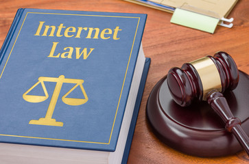 A law book with a gavel - Internet  law