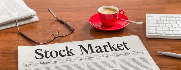 A newspaper on a wooden desk - Stock Market