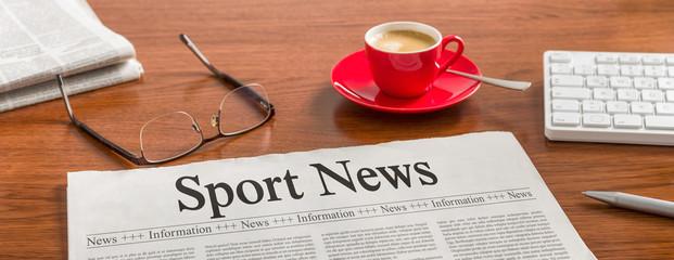 A newspaper on a wooden desk - Sport News