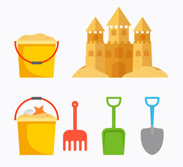 Beach sand castle with children's bucket, sand bucket, shovel, r