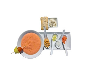 Gazpacho soup and ingredients display isolated on white