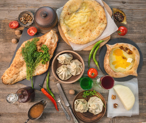 tatar khinkali, khachapuri, on the table, topview