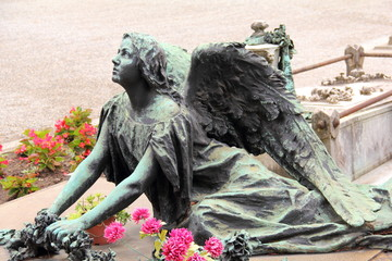 Winged Angel Woman Sculpture in Milan Monumental cemetery